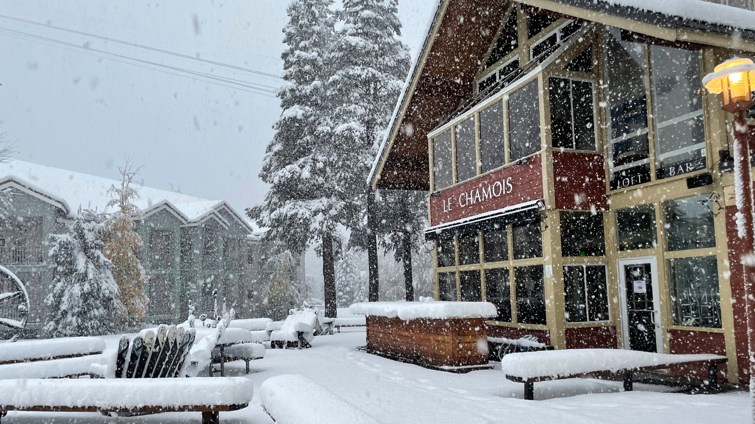 In this image taken on Oct. 25, 2021, and provided by Palisades Tahoe, snow falls at the ski resort in Olympic Valley, Calif. (Palisades Tahoe via AP)