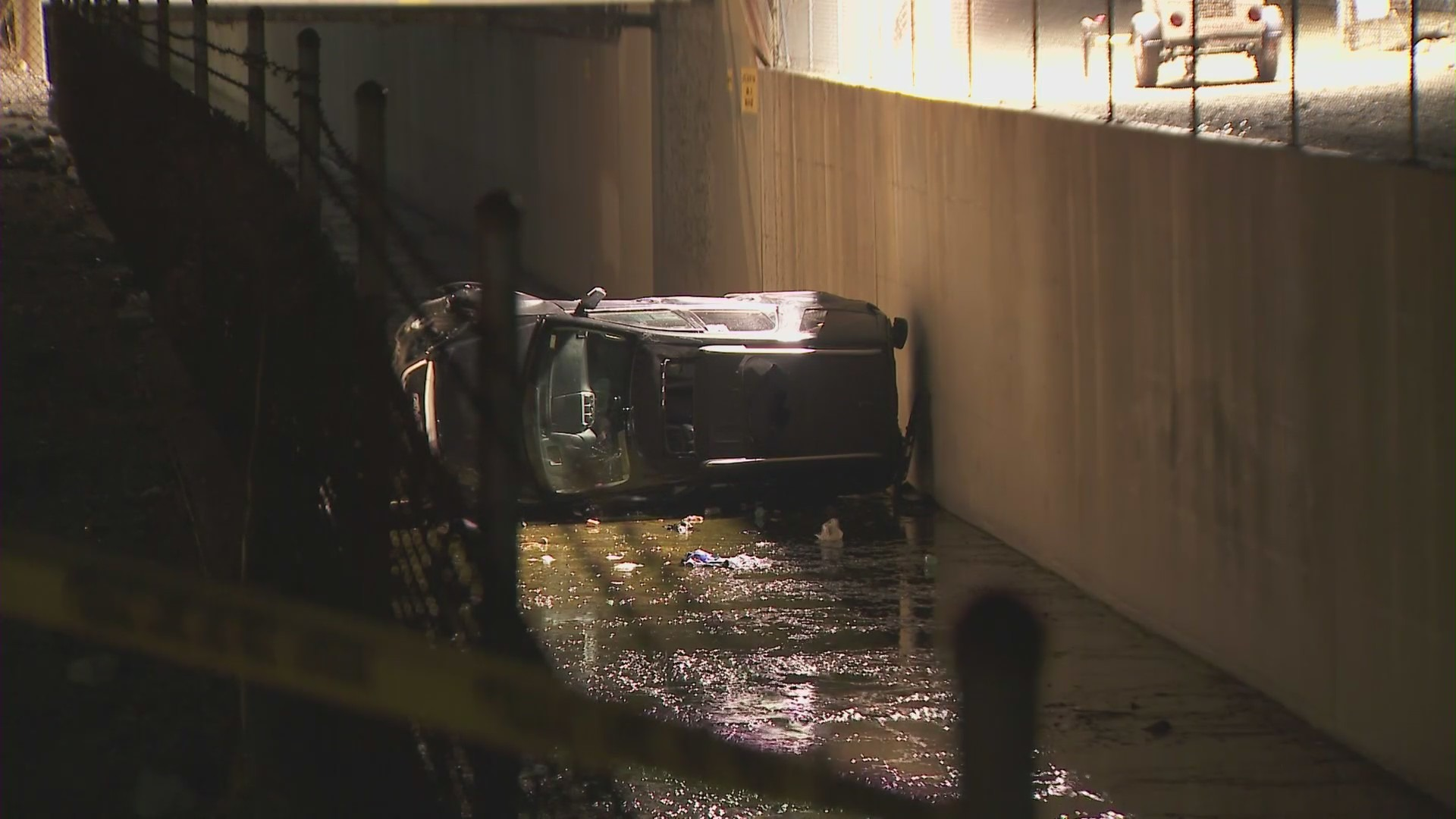 A car ending up in a drainage canal after police in Azusa shot a man on Oct. 22, 2021. (KTLA)