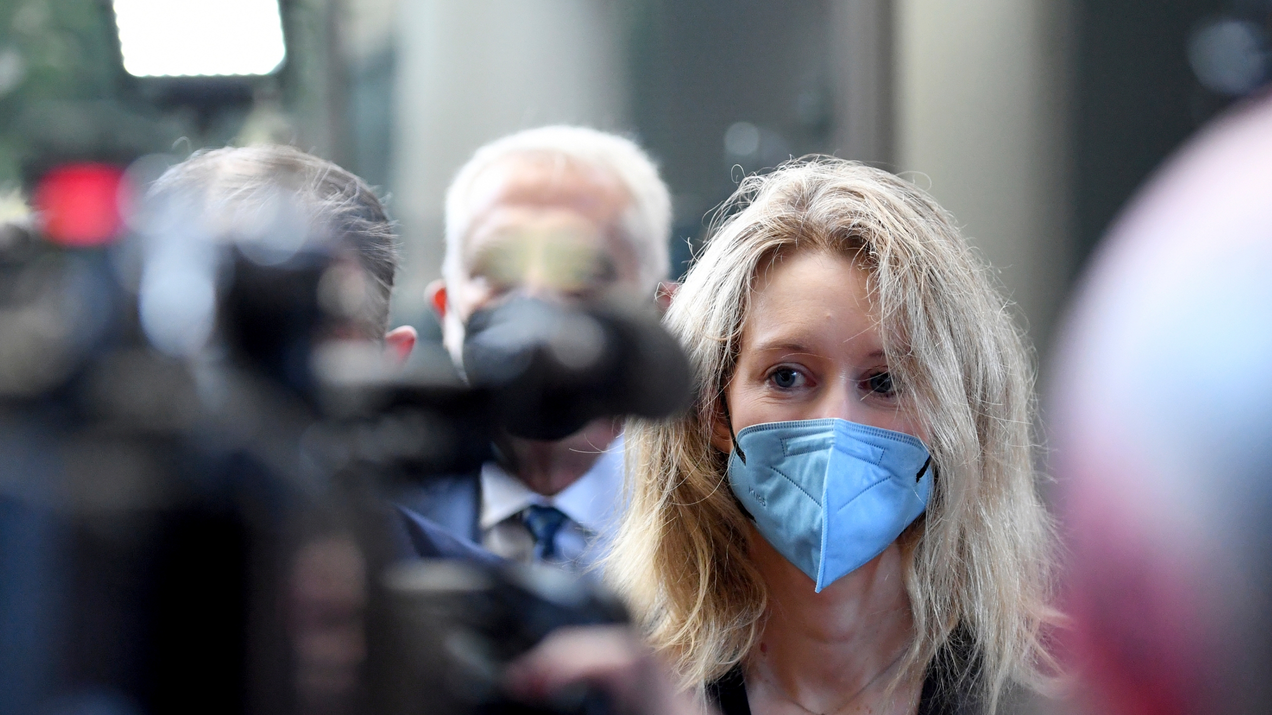 In this Tuesday, Aug. 31, 2021, file photo, Elizabeth Holmes, founder and CEO of Theranos, arrives at the federal courthouse for jury selection in her trial, in San Jose, Calif. A jury weighing the fate of fallen Silicon Valley star Holmes got its first chance Friday, Oct. 22, to listen to recordings of her boasting to investors about purported breakthroughs in a blood-testing technology. (AP Photo/Nic Coury)