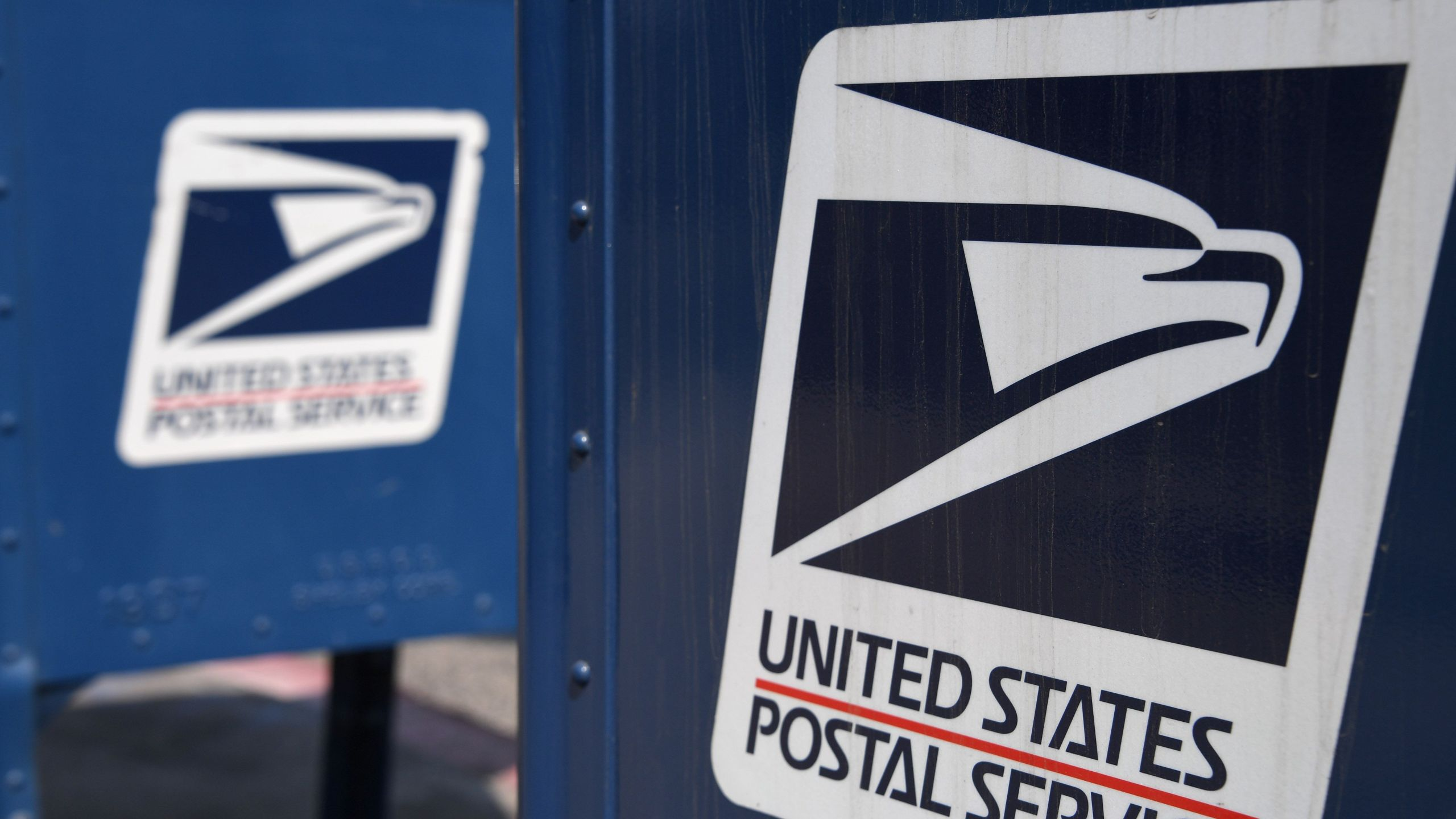 The United States Postal Service logo is seen on a mailbox outside a post office in Los Angeles, California, August 17, 2020. (ROBYN BECK/AFP via Getty Images)