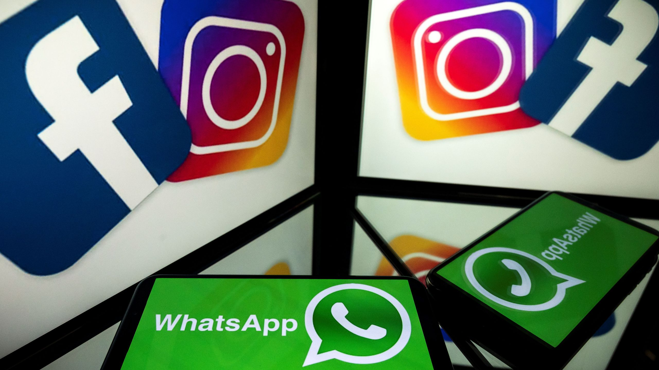 This picture, taken on Oct. 5, 2020, shows logos of social networks Facebook, Instagram and Whatsapp. (LIONEL BONAVENTURE/AFP via Getty Images)