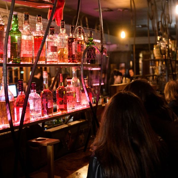 Fully vaccinated customers gather at the bar inside Risky Business in North Hollywood on May 21, 2021. (PATRICK T. FALLON/AFP via Getty Images)