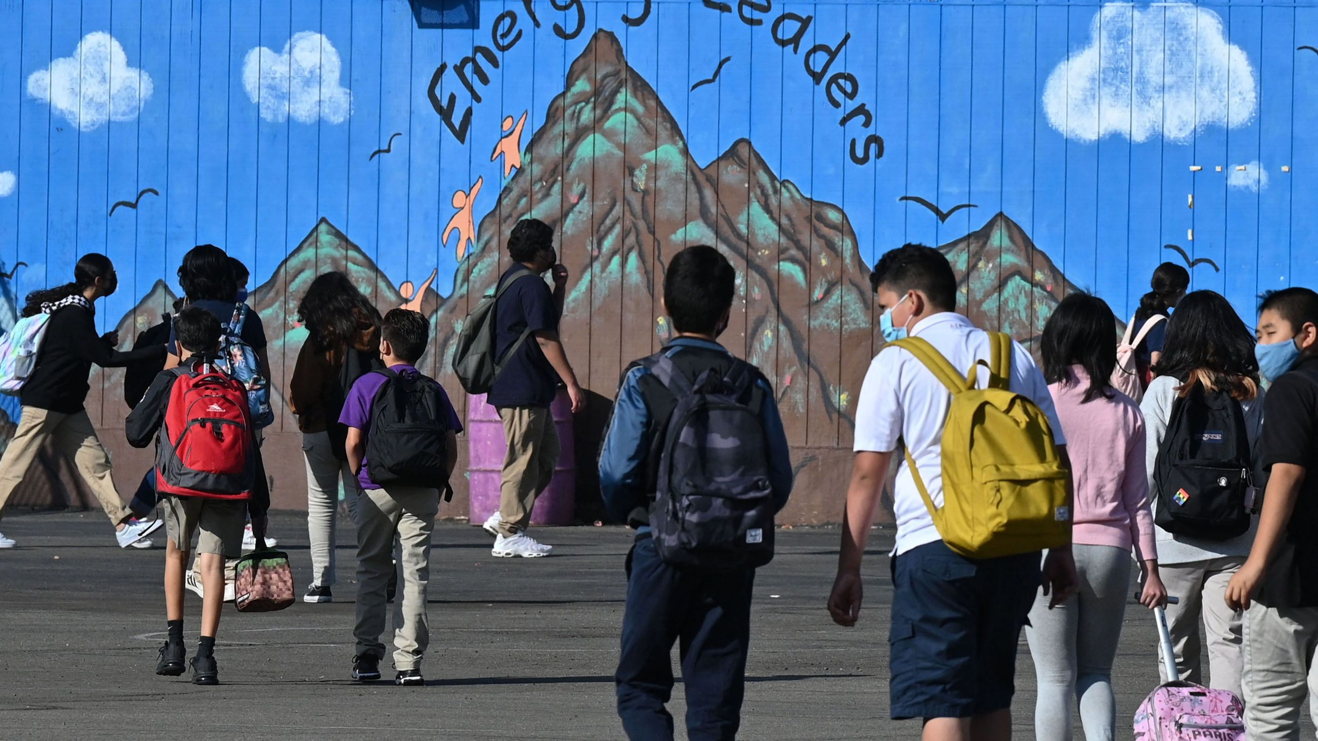 Students walk to their classrooms at a public middle school in Los Angeles on Sept. 10, 2021. (ROBYN BECK/AFP via Getty Images)