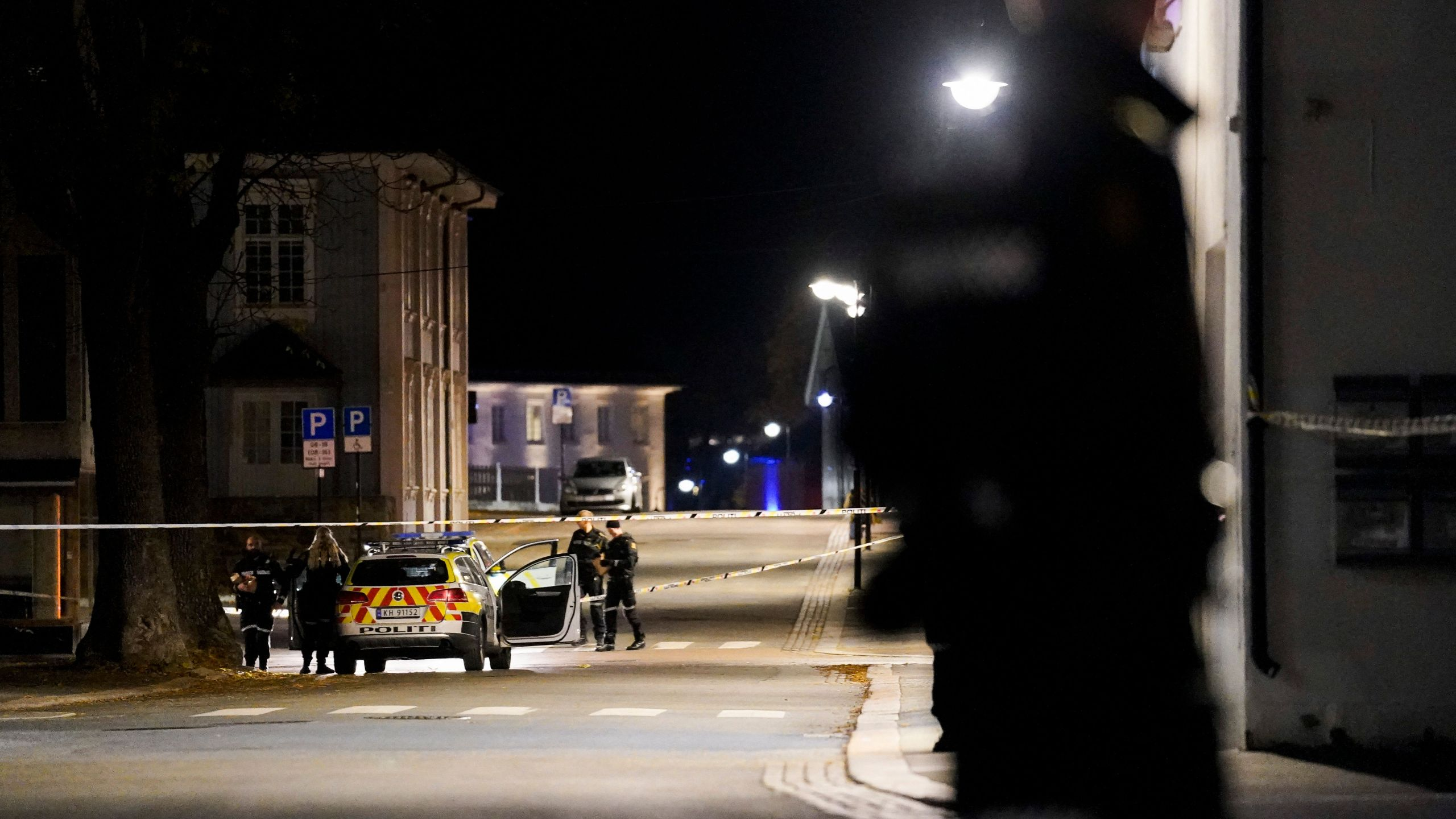 Police officers cordon off the scene where they are investigating in Kongsberg, Norway after a man armed with bow killed several people before he was arrested by police on October 13, 2021. (HAKON MOSVOLD LARSEN/NTB/AFP via Getty Images)