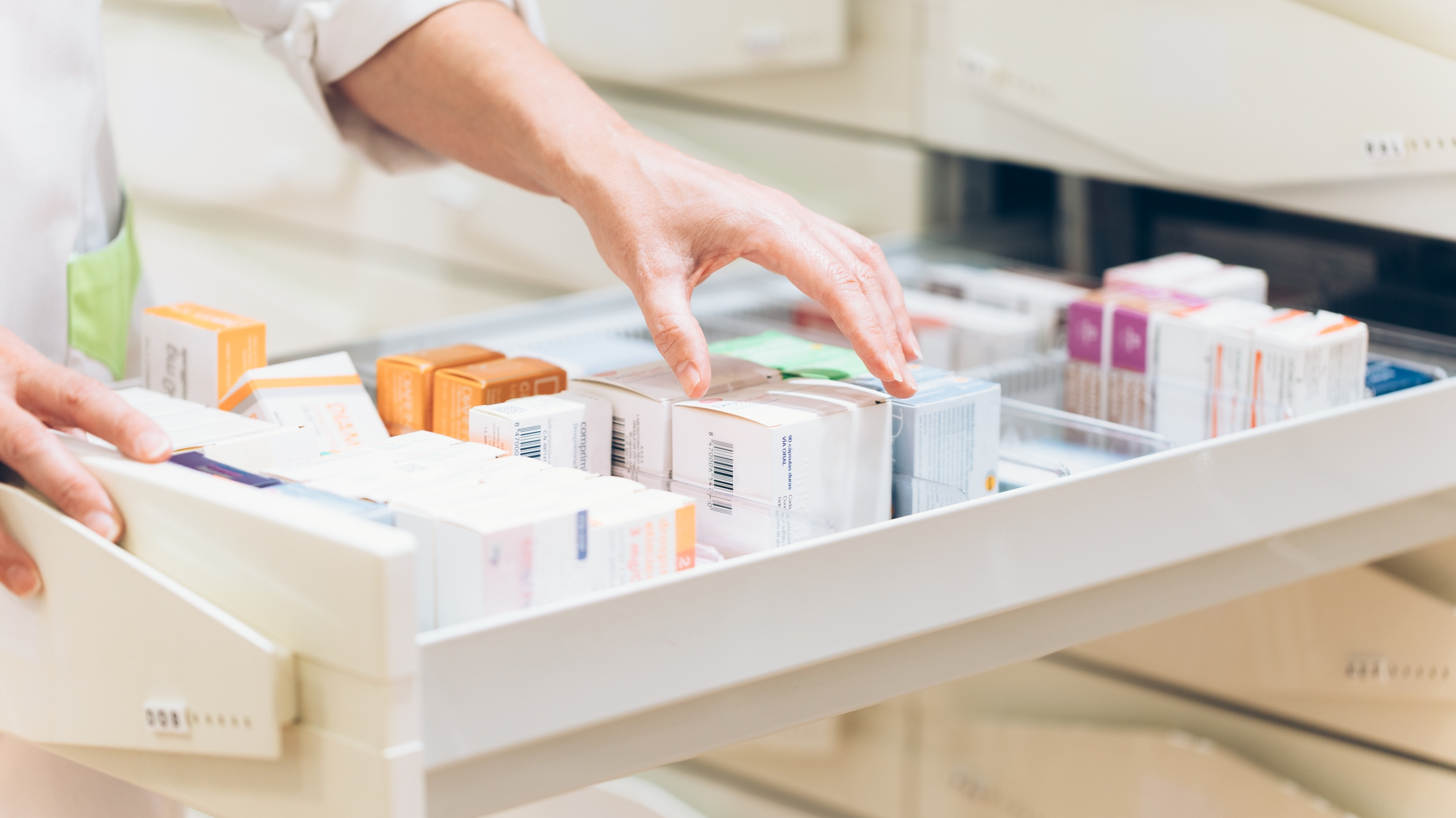 A pharmacist takes medication from a drawer in this undated file photo. (Getty Images)