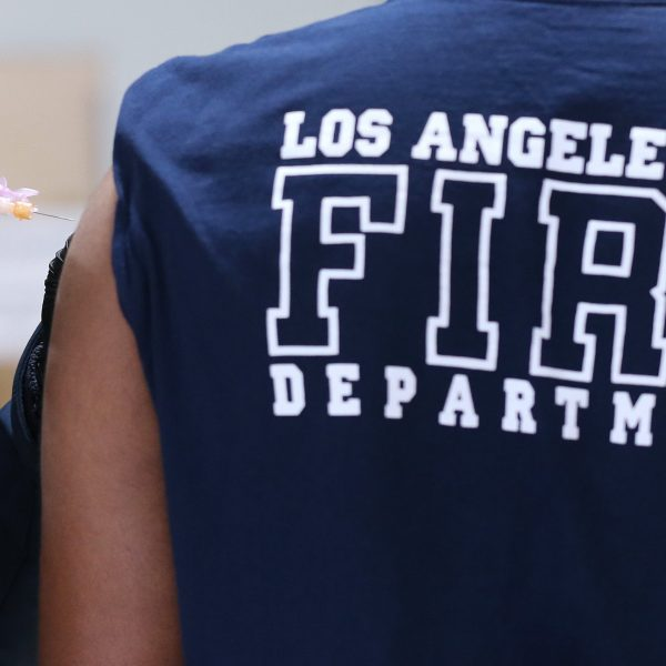 A Los Angeles Fire Department firefighter receives a Moderna COVID-19 vaccination dose at a fire station on Jan. 29, 2021. (Mario Tama / Getty Images)