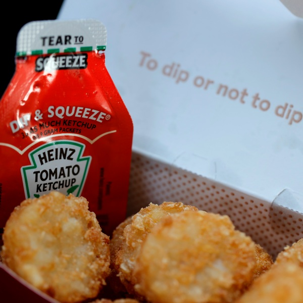 A packet of Heinz ketchup is displayed with Chick-fil-A hash browns on April 12, 2021, in Novato, California. (Justin Sullivan / Getty Images)