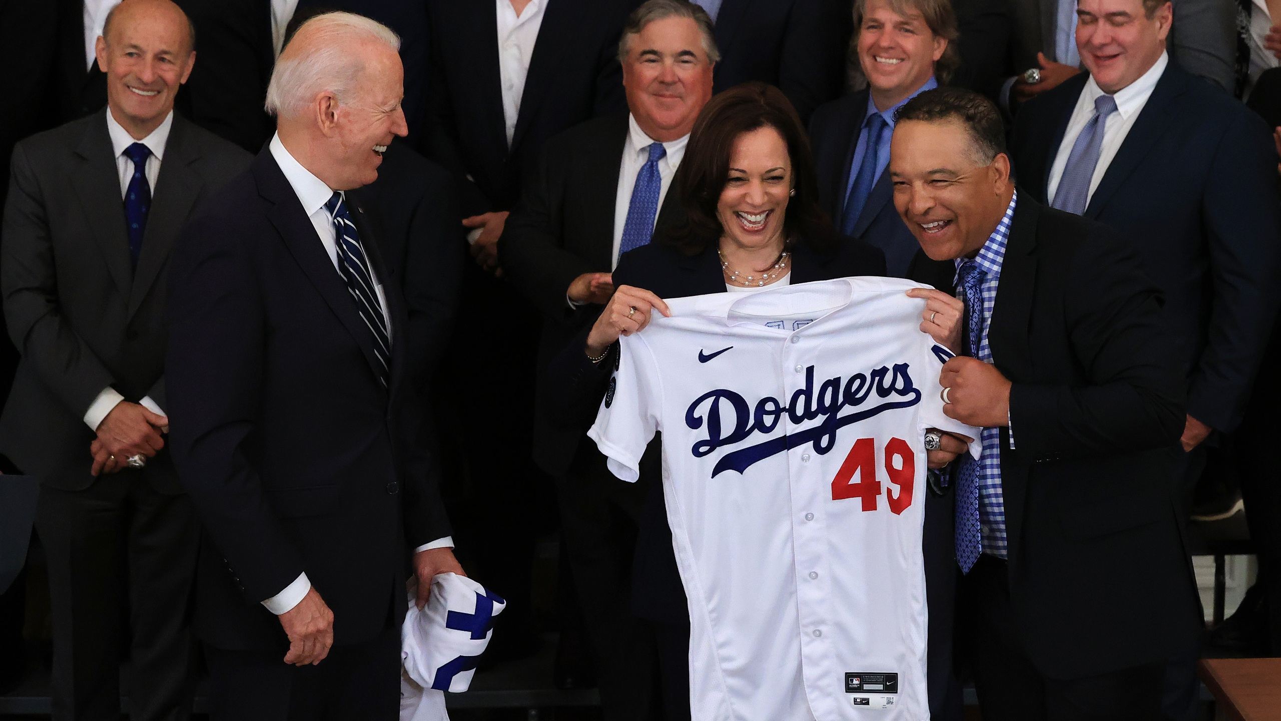 Vice President Kamala Harris, seen here being presented with a Dodgers jersey earlier this year during a team visit to the White House, will be rooting for the San Francisco Giants in the playoffs. (Chip Somodevilla / Getty Images)