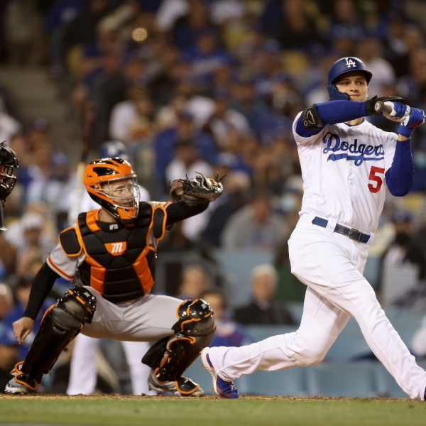 Corey Seager #5 of the Los Angeles Dodgers checks his swing allowing for a walk in front of Buster Posey #28 of the San Francisco Giants during the fourth inning in game 3 of the National League Division Series at Dodger Stadium on Oct. 11, 2021, in Los Angeles, California. (Harry How/Getty Images)