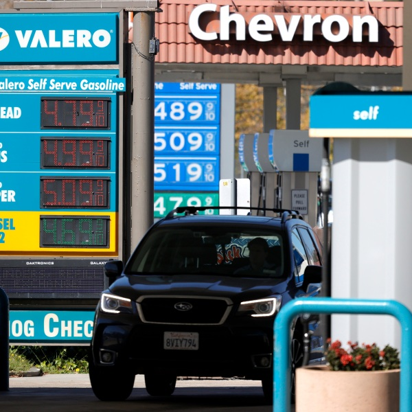 Gas prices nearing $5.00 per gallon are displayed at Valero and Chevron stations on October 12, 2021 in Mill Valley. (Justin Sullivan/Getty Images)