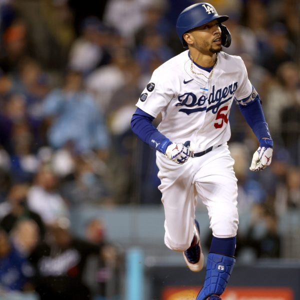 Mookie Betts of the Los Angeles Dodgers watches his two-run home run against the San Francisco Giants during the fourth inning in game 4 of the National League Division Series at Dodger Stadium on Oct. 12, 2021. (Harry How / Getty Images)
