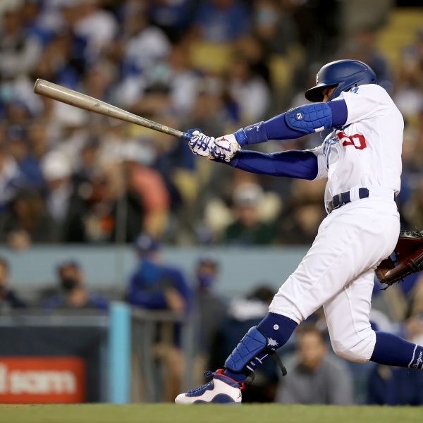 Mookie Betts #50 of the Los Angeles Dodgers watches his single against the San Francisco Giants during the second inning in game 4 of the National League Division Series at Dodger Stadium on Oct. 12, 2021, in Los Angeles, California. (Ronald Martinez/Getty Images)