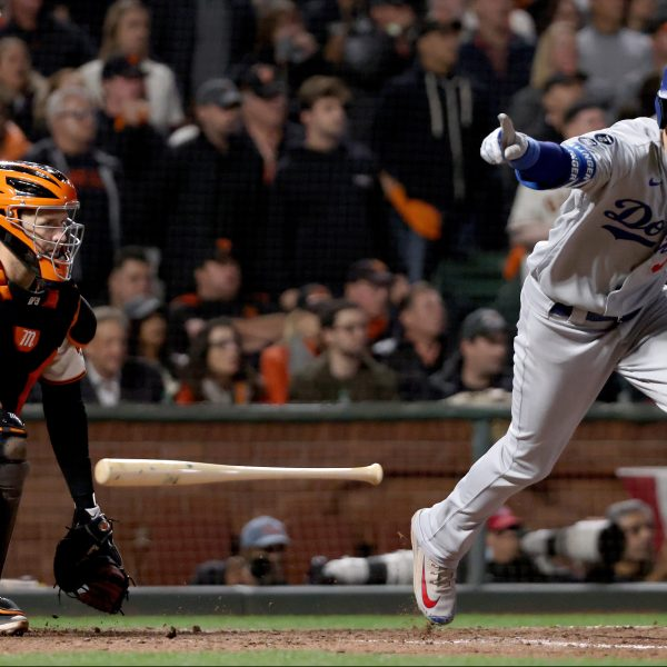 Cody Bellinger of the Los Angeles Dodgers celebrates his RBI single to score Justin Turner against the San Francisco Giants during the ninth inning in game 5 of the National League Division Series at San Francisco's Oracle Park on Oct. 14, 2021. (Harry How / Getty Images)