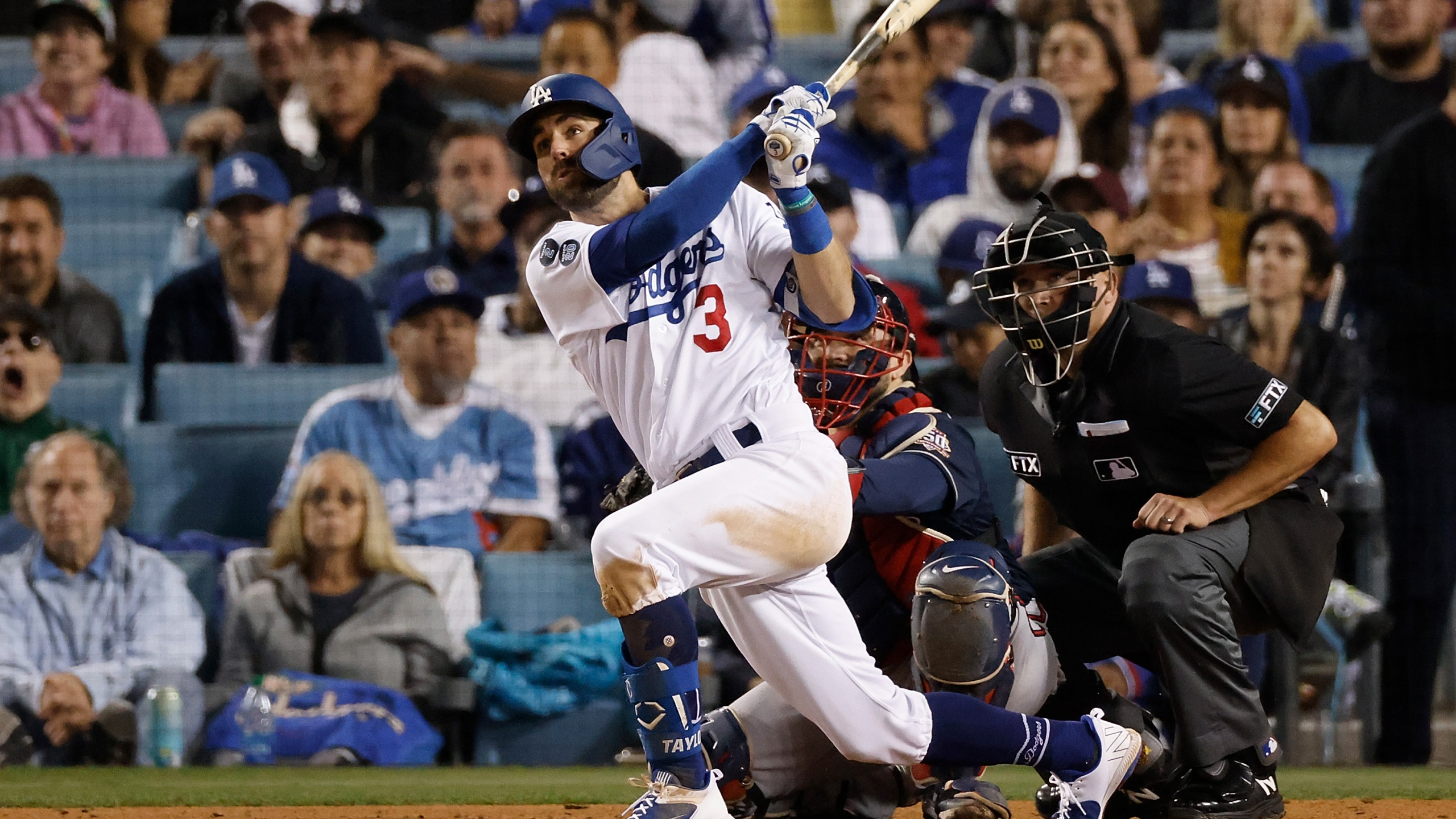 Chris Taylor #3 of the Los Angeles Dodgers hits a solo home run during the seventh inning of Game Five of the National League Championship Series against the Atlanta Braves at Dodger Stadium on Oct. 21, 2021, in Los Angeles, California. (Sean M. Haffey/Getty Images)