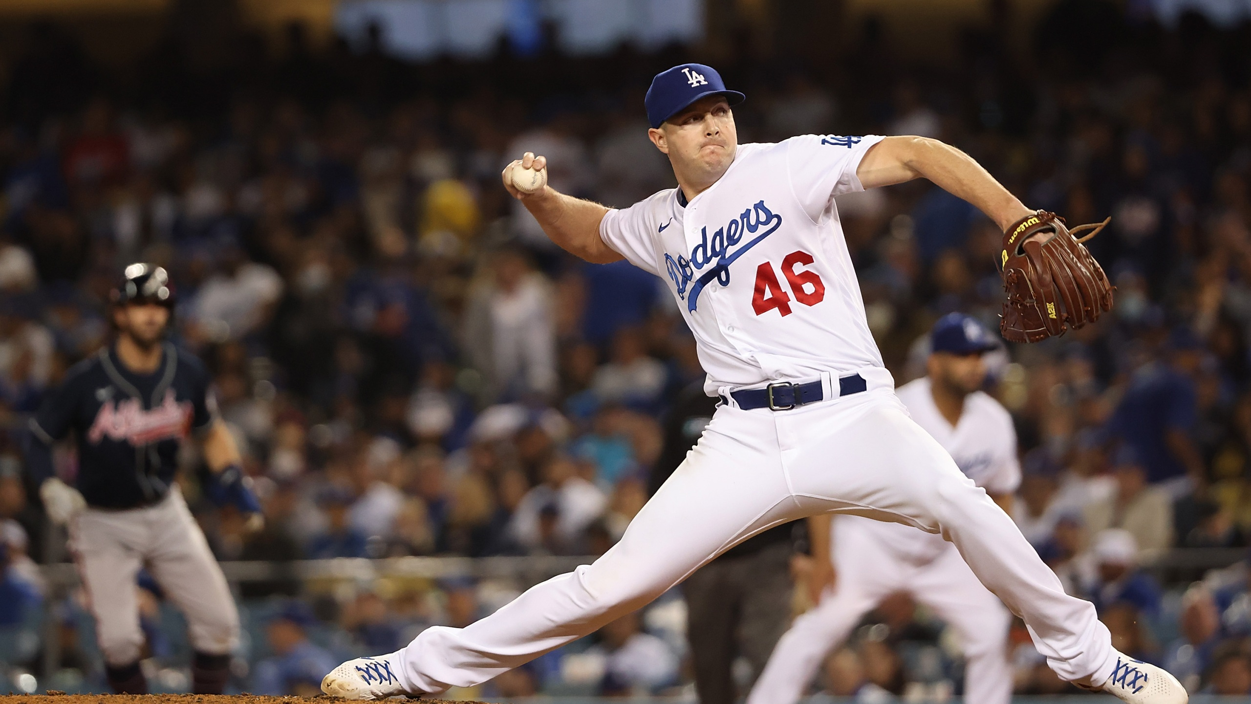 Corey Knebel #46 of the Los Angeles Dodgers throws a pitch during the eighth inning of Game Five of the National League Championship Series against the Atlanta Braves at Dodger Stadium on Oct. 21, 2021, in Los Angeles, California. (Harry How/Getty Images)