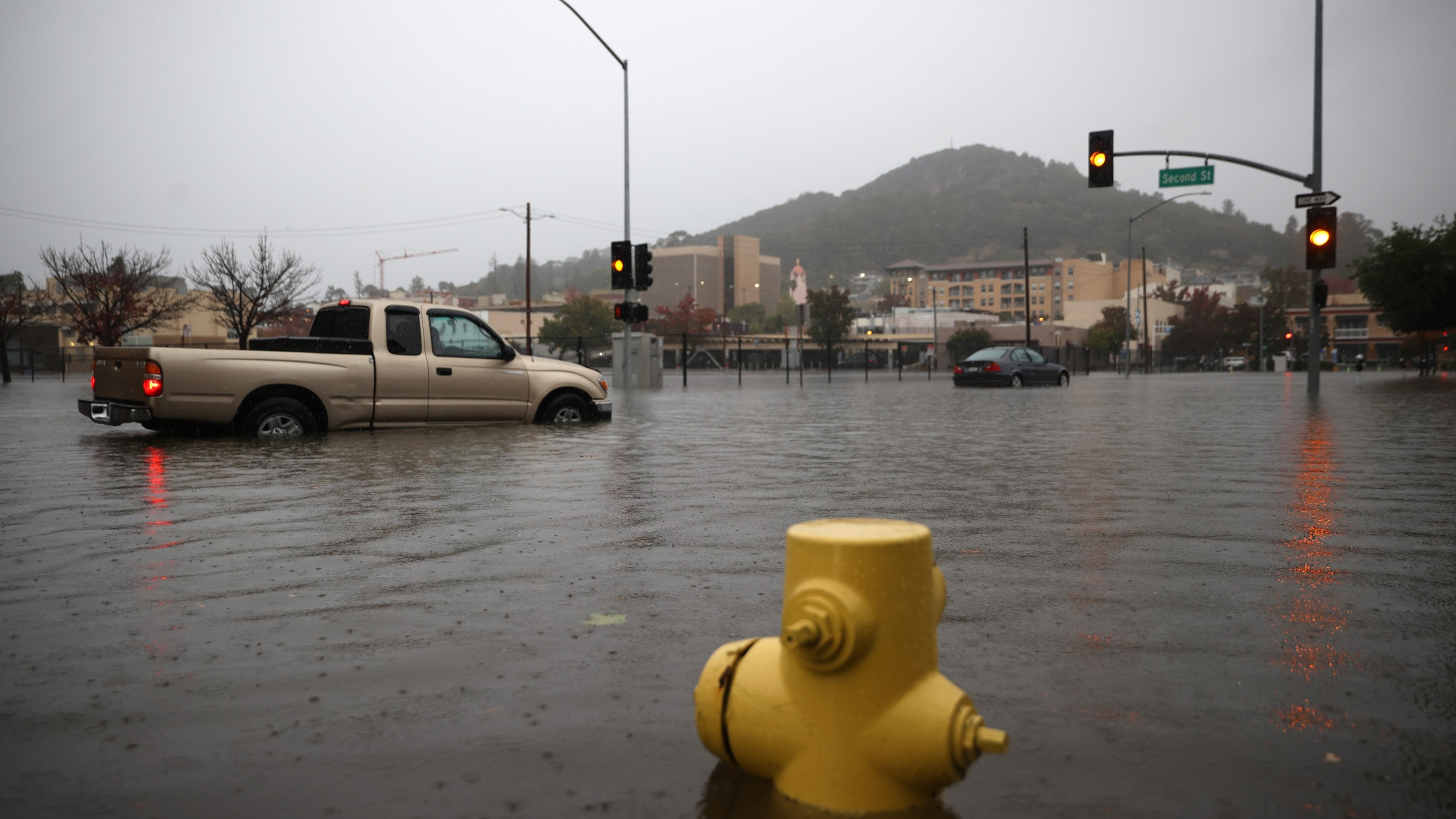 Cars try to navigate a flooded street on Oct. 24, 2021 in San Rafael. (Justin Sullivan/Getty Images)