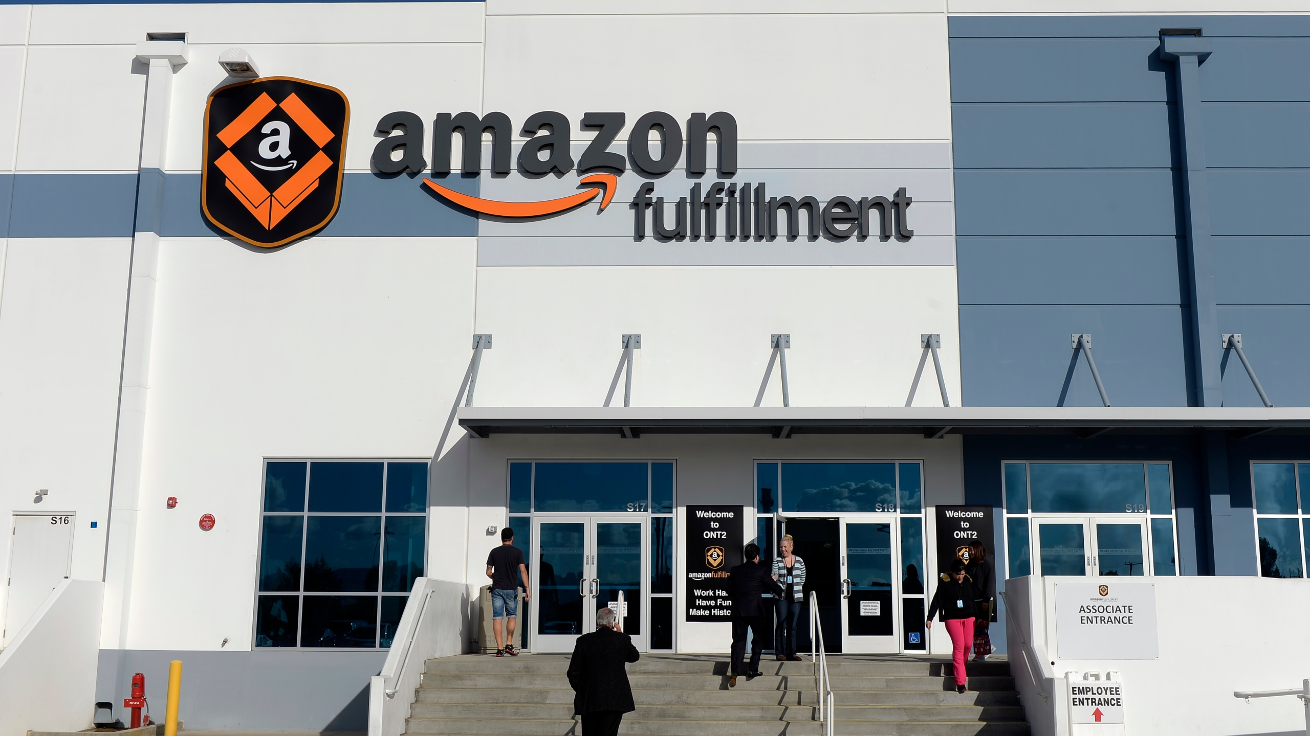 Employees arrive at Amazon's San Bernardino Fulfillment Center October 29, 2013 in San Bernardino. (Kevork Djansezian/Getty Images)