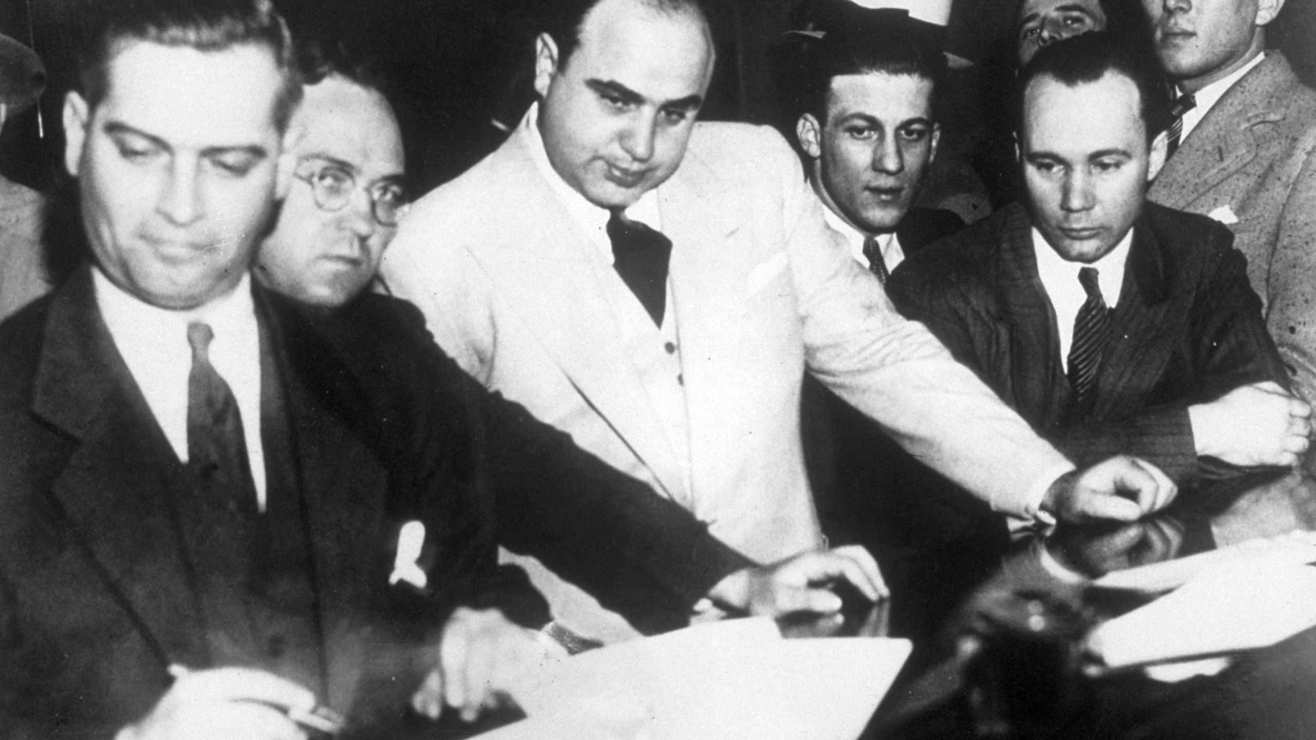 Al Capone (1899 - 1947) signing Uncle Sam's $50,000 bail bond in the Federal Building, Chicago. (Topical Press Agency/Getty Images)