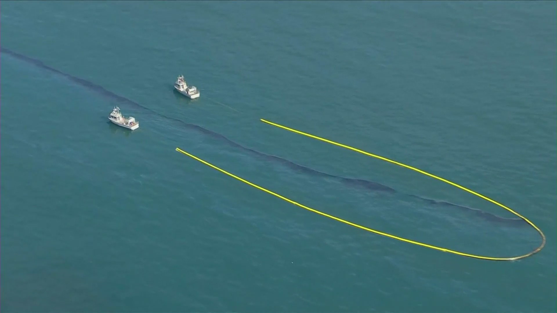 Boats attempt to remove oil from the Pacific Ocean on Oct. 3, 2021. (KTLA)