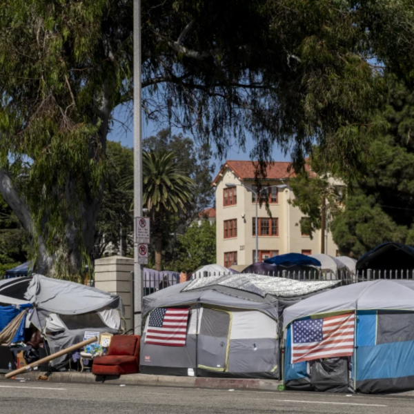 A homeless encampment known as Veterans Row outside the Veterans Affairs campus on San Vicente Boulevard in West Los Angeles.(Francine Orr / Los Angeles Times)