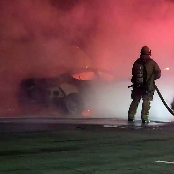 Emergency personnel respond to a car fire in San Bernardino on Oct. 18, 2021. (OnScene.TV)