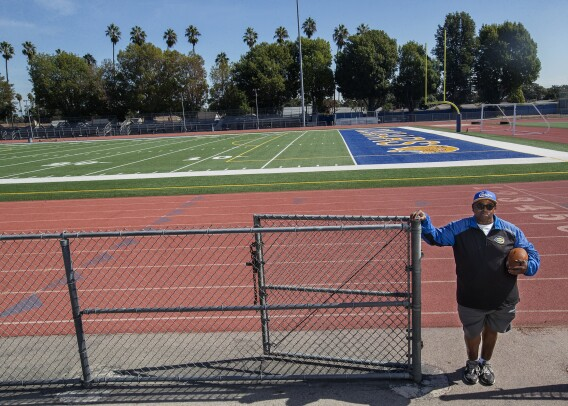 Crenshaw High School football coach Robert Garrett, seen in this undated photo, tells his players that he understands their COVID-vaccine hesitancy. He was reluctant himself. (Mel Melcon / Los Angeles Times)