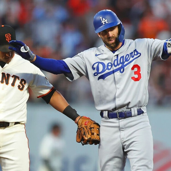 Los Angeles Dodgers' Chris Taylor gestures after hitting a double during the National League Division Series Saturday, Oct. 9, 2021, in San Francisco. (AP Photo/John Hefti)