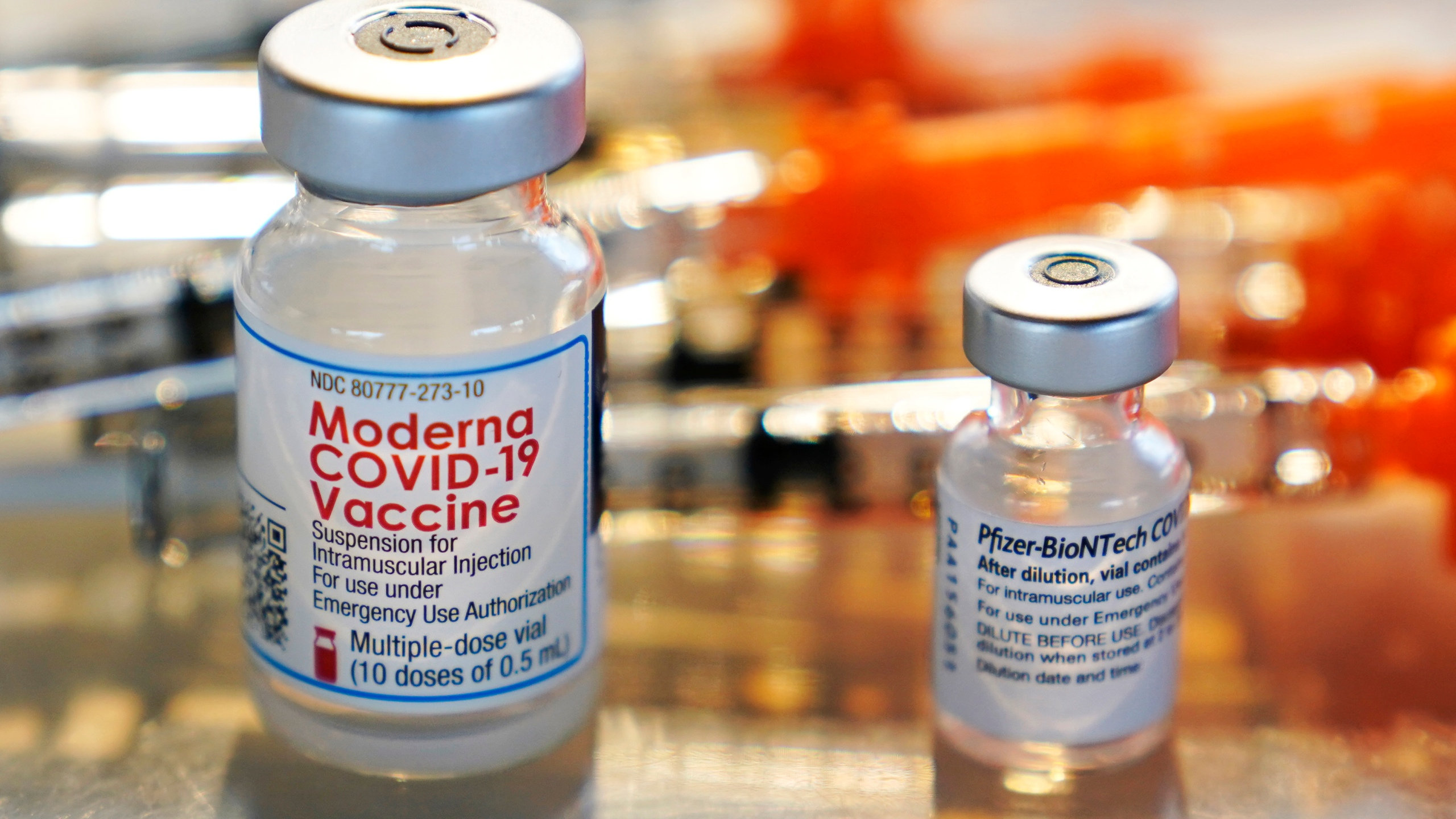 This Thursday, Feb. 25, 2021 file photo shows vials for the Moderna and Pfizer COVID-19 vaccines. (AP Photo/Charles Krupa)