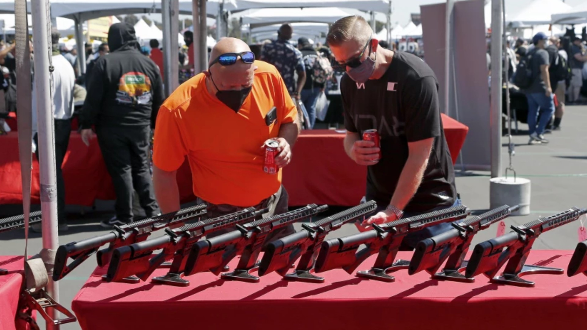 Gun enthusiasts check out sporting rifles in March during the Crossroads of the West Gun Show at the Orange County fairgrounds in Costa Mesa.(Kevin Chang / Times Community News)