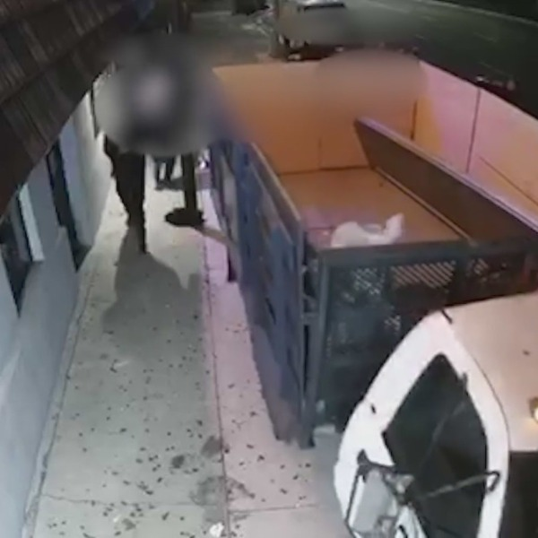 Surveillance video obtained by KTLA shows a truck that drove onto sidewalk before the man driving it was fatally beaten on Oct. 9, 2021.