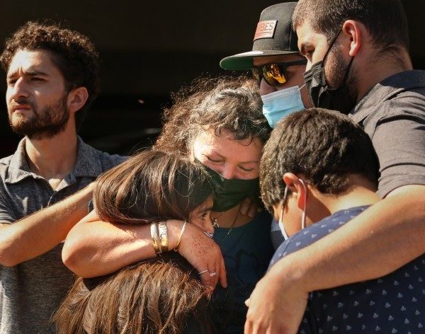 Manuela Sahagun, mother of Mona Rodriguez, center, hugs family members during a news conference outside Long Beach Memorial Care Hospital on Oct. 1, 2021. (Carolyn Cole / Los Angeles Times)