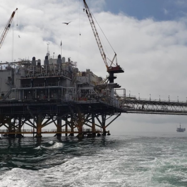 Oil platforms Elly, left, and Ellen stand about nine miles offshore from Huntington Beach in this image taken Aug. 27, 2019.(Sean Greene / Los Angeles Times)