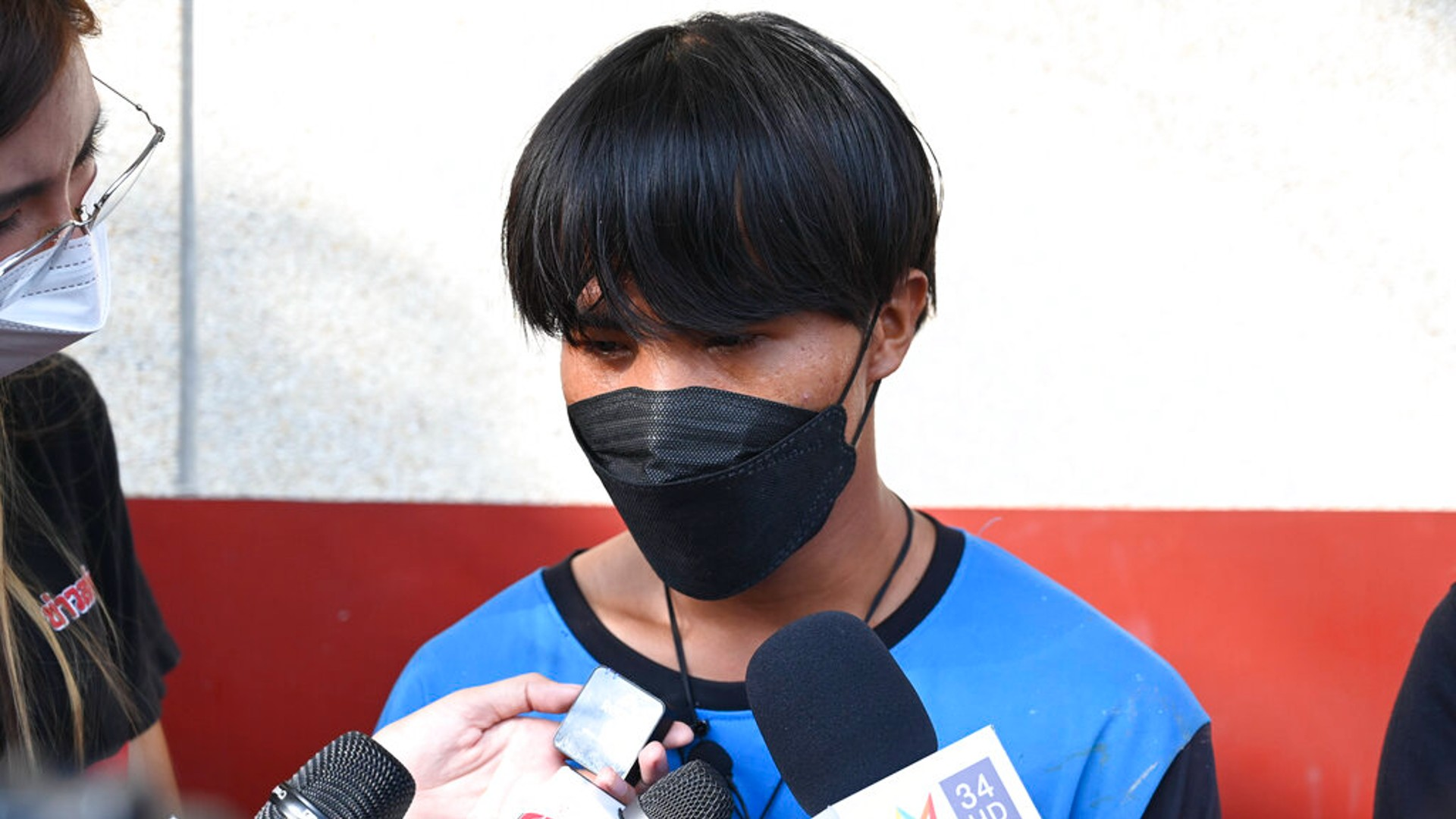 A Myanmar national identified as Song, one of two painters rescued from a high-rise condominium in Thailand, talks to reporters at Pak Kret police station in Nonthaburi near Bangkok, Wednesday, Oct. 27, 2021. (AP Photo/Surat Sappakun)