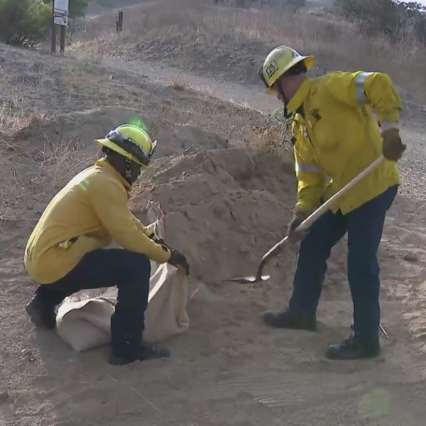 Firefighters demonstrate how to properly sandbag in this file photo. (KTLA)