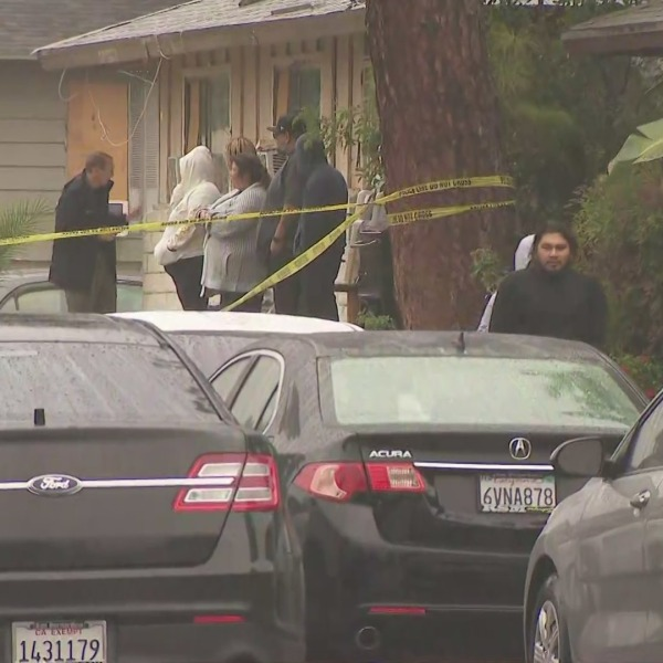 Investigators on Oct. 8, 2021, respond to a deadly shooting that occurred in Rialto the night before. (KTLA)