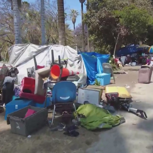 Items from a homeless encampment are seen near MacArthur Park in this undated file image. (KTLA)
