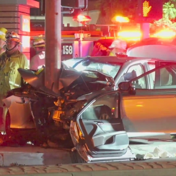 Emergency personnel respond to a fatal crash in Gardena on Oct. 19, 2021. (OnScene.TV)