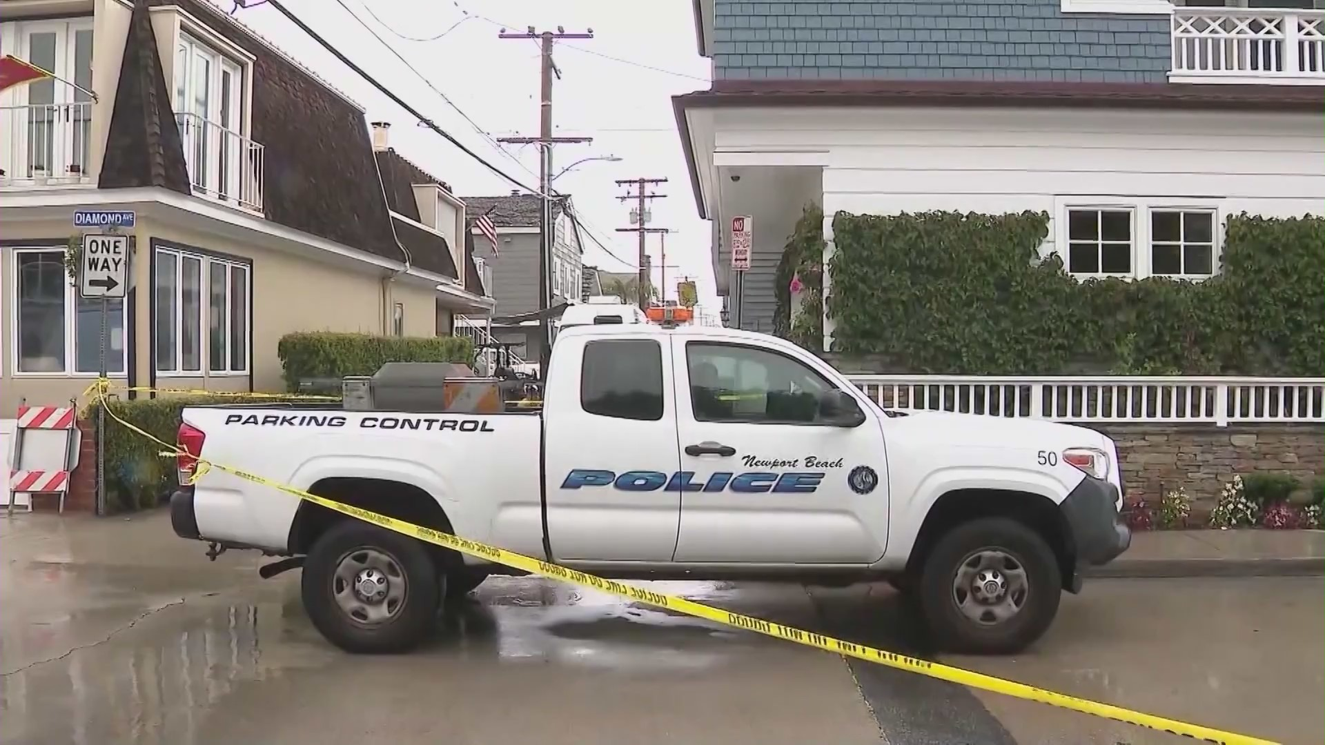 Newport Beach Police Department officers are investigating after three people were found dead in a back apartment unit on Balboa Island on Oct. 26, 2021. (KTLA)