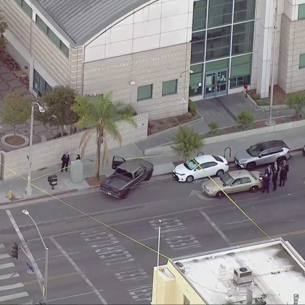 Law enforcement are seen after a Los Angeles officer was shot near the LAPD's Newton station in South L.A. on Oct. 14, 2021. (KTLA)