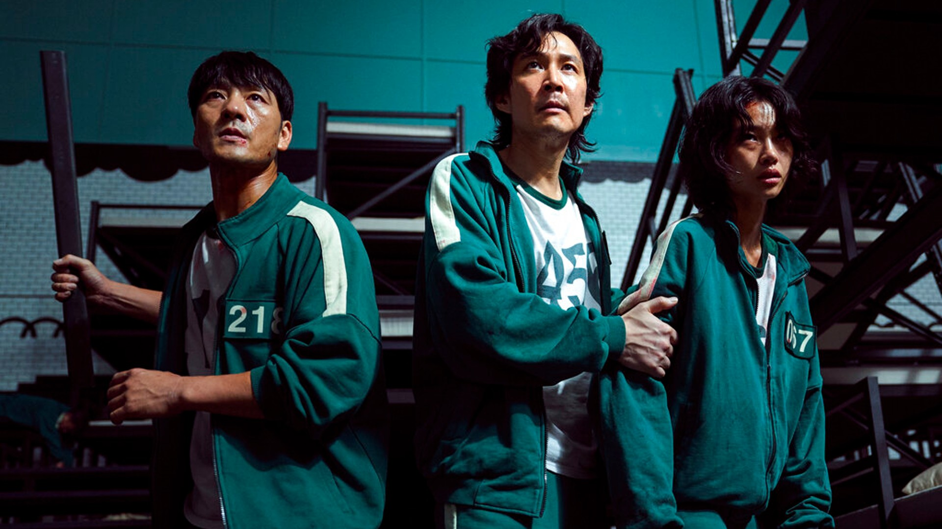 """This undated photo released by Netflix shows South Korean cast members, from left, Park Hae-soo, Lee Jung-jae and Jung Ho-yeon in a scene from """"Squid Game."""" (Youngkyu Park/Netflix via AP)"""