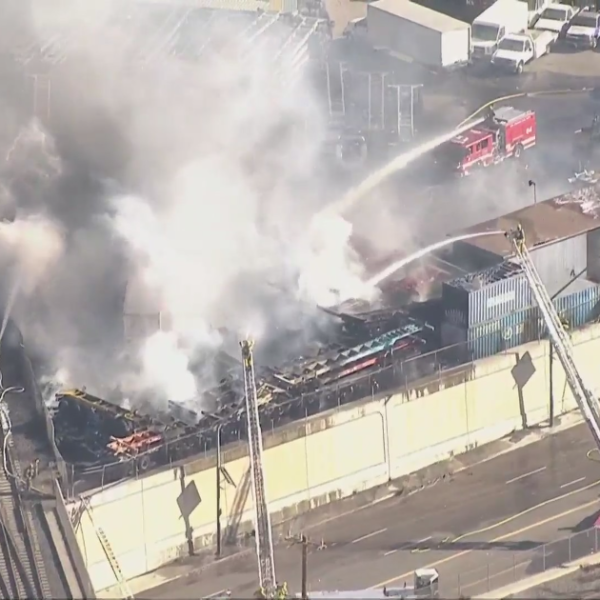Los Angeles firefighters work to put out a blaze in Wilmington on Oct. 13, 2021. (KTLA)
