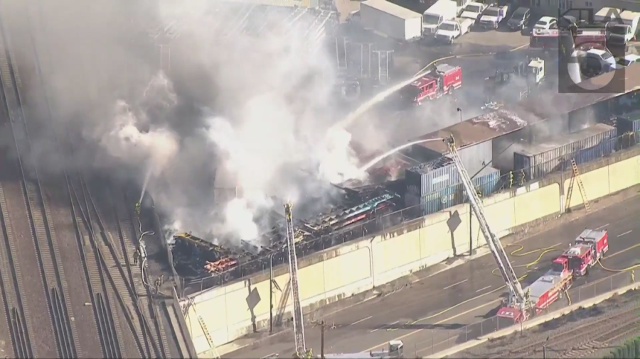 Firefighters put out container yard blaze in Wilmington that prompted closure of area railway